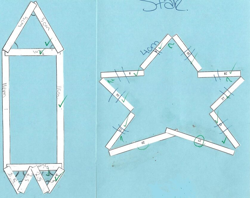 cut and paste of white strips of paper on blue card showing geometry of a rocket and a star